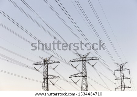 Electricity pylons on soft gradient sky background. #1534434710