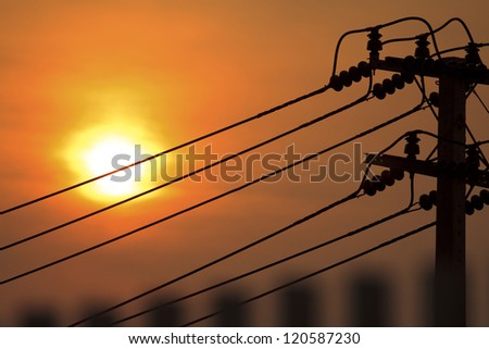 Electricity pylons silhouette at sunset