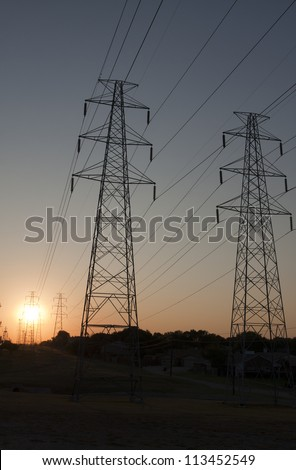 Electricity towers on the plains with sun rise in the background