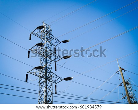 electricity transmission pylon with sky background, blue toned images