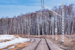 Electrified railway line at winter day time.