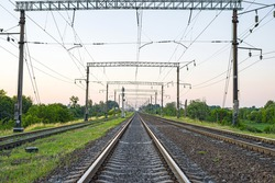 Electrified Railway - tracks, concrete sleepers, traffic lights and power lines