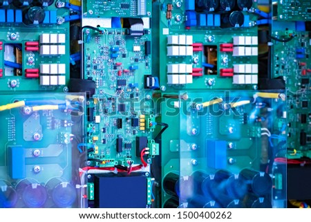 Electro circuits. Protected microcircuit. Safety glass over paid. Chip development. The fee for the electrical equipment. Close-up electronic circuit board. technology style concept. Electronics. #1500400262