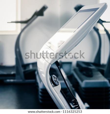 Electro muscular stimulation machine in modern fitness center #1116325253