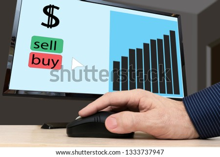 Electronic bidding. Graph of exchange rates on a computer screen. A man buys dollars.
