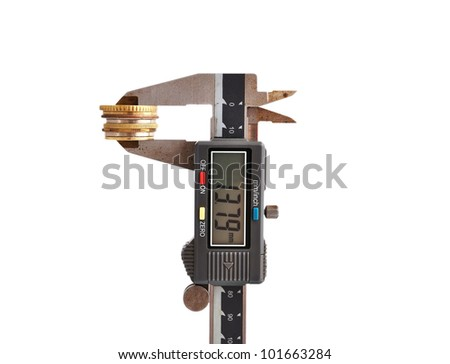 electronic calipers and coin on a white background