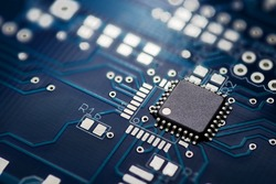 Electronic chip component on the blue printed circuit board