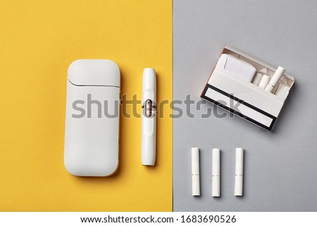 Electronic Cigarette Technology. Tobacco IQOS system. Close-up an electric hybrid cigarette with a heating pad. tobacco heating system. New tobacco heating system. Electronic cigarette mocap.