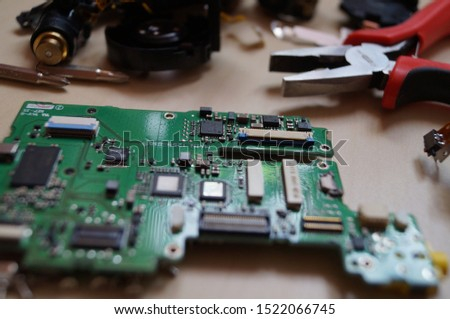 Electronic circuit board close up with measuring devices in the electronics engineer laboratory, used for wallpaper, used as illustrated book #1522066745