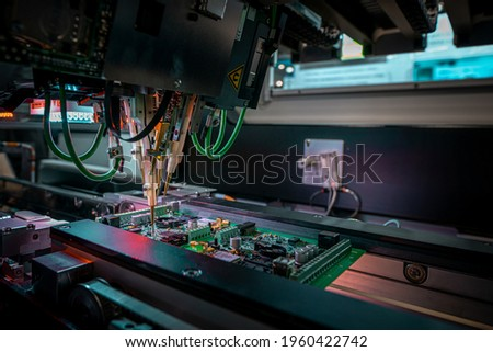 Electronic circuit board production. Automated Circut Board machine Produces Printed digital electronic board. Electronics contract manufacturing. Manufacture of electronic chips. High-tech