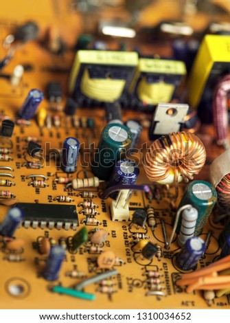 Electronic circuit board with components, close up image. Electronics recycling or electronics repair conceptual picture. #1310034652