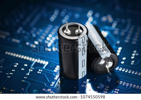 Electronic component capacitor on the blue printed circuit board