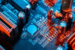 Electronic components on a printed circuit board. Resistor, inductor and capacitor on PCB. Concept Electrical engineering, microprocessor, technology. Selective focus