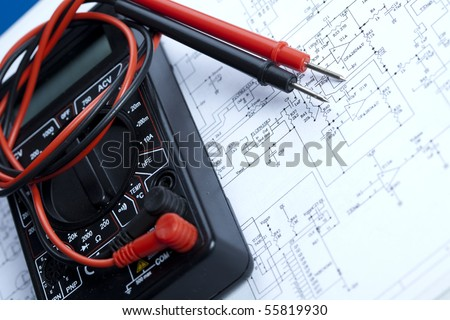Electronic components on a schematic diagram background.