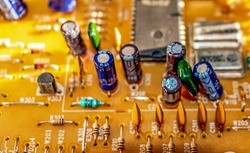 electronic components resistors and capacitors on TV circuit board