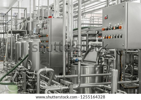 electronic control panel and tank at a milk factory. equipment at the dairy plant #1255164328