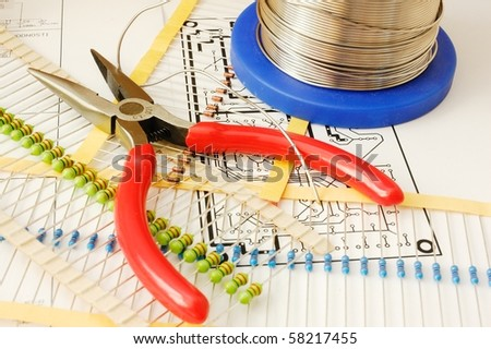 Electronic devices and tools on schematic background