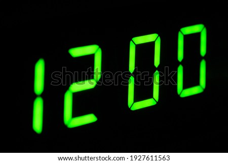 Electronic digital clock close-up. The clock is 12 o'clock. The clock can be used as an alarm clock. Modern technologies.