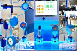 Electronic digital pressure gauge and water flow calculation equipment at an industrial exhibition