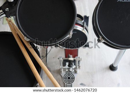 Electronic drum kit and drum sticks.