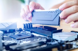 Electronic engineer of computer technology. Maintenance computer hardware upgrade of motherboard putting the Ram on the motherboard computer