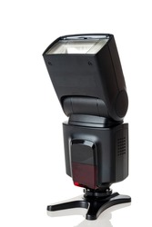 Electronic flash, pulsed photo illuminator, an artificial lighting source designed to create short-term light flashes of high intensity, isolated on a white background