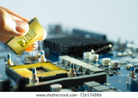 Electronic hardware computer technology background engineer maintenance cpu upgrade of motherboard component. Pc repair, technician and industry support concept closeup circuit board digital microchip #726576886