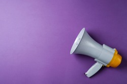 Electronic megaphone on color background