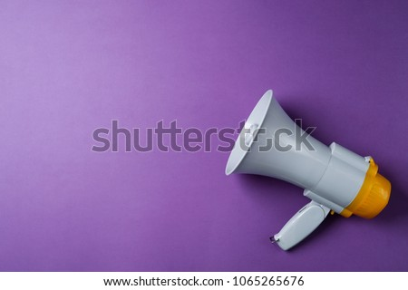 Electronic megaphone on color background #1065265676