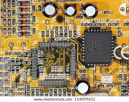 Electronic microcircuit and microchip taken closeup.