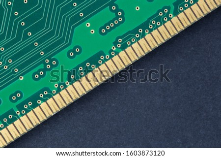 Electronic microcircuit. Electronic chip. Dark background. Electronics repair concept. Space for copy.