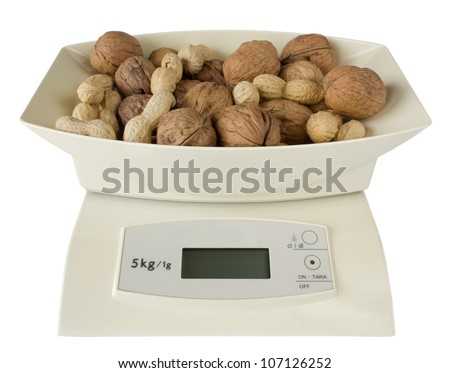 Electronic Scales with Walnuts and Peanuts - stock photo