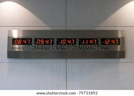 Electronic scoreboard showing the time in the five capitals of the world