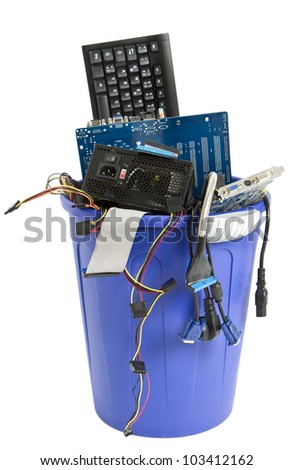 electronic scrap in trash can. keyboard, cables, logicbaord, power supply