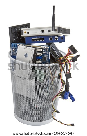 electronic scrap in trash can. keyboard, power supply, cables, logic board, hard drive - isolated on white background - stock photo