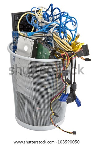 electronic scrap in trash can. keyboard, power supply, cables, logicboard, hard drive - isolated on white background