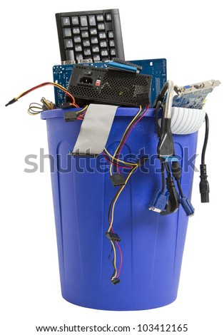 electronic scrap in trash can. keyboard, power supply, cables, logicboard - isolated on white background