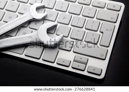 electronic technical support concept - spanners on computer keyboard Stock foto ©