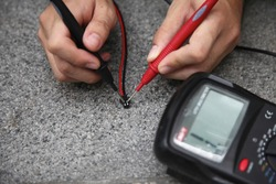 electronic test and measurement with multimeter. A multimeter check for continuity