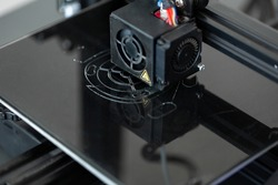 Electronic three dimensional plastic 3D printer during work in laboratory