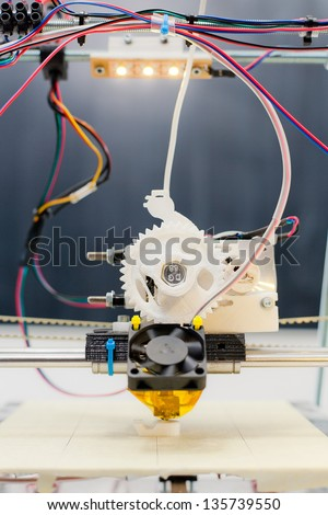 Electronic three dimensional plastic printer during work in school laboratory 3D printer 3D printing