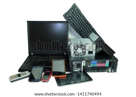 Electronic waste, gadgets electronic equipment for daily use, Laptop and Desktop computer and cell phones isolated on white background #1411740494