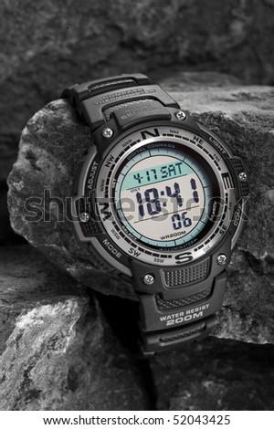 Electronic waterproof watch on grey stones