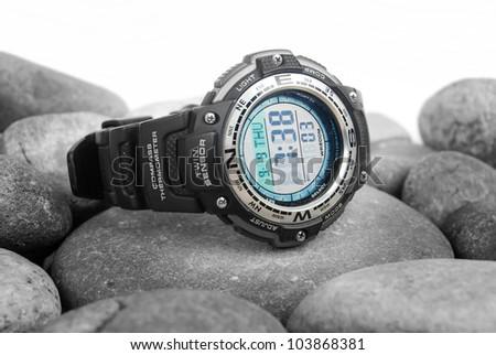 Electronic waterproof watch on stone