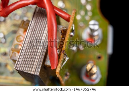 Electronics from old electronic devices. Parts for repair in an electronics workshop. Dark background. #1467852746