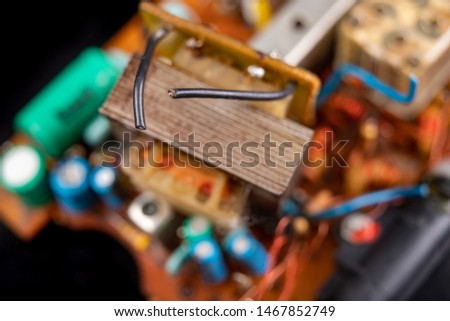 Electronics from old electronic devices. Parts for repair in an electronics workshop. Dark background. #1467852749