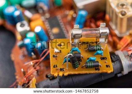 Electronics from old electronic devices. Parts for repair in an electronics workshop. Dark background. #1467852758