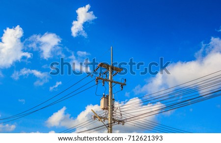 Electronics line wired with tower with sky background. #712621393