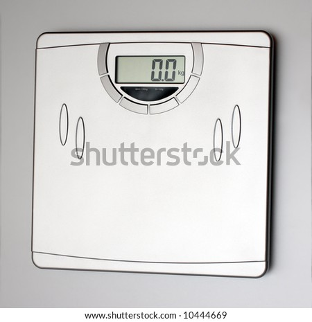 electronics scales close-up on grey background
