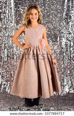 elegance and stylish look. elegance, little girl in dress #1077884717